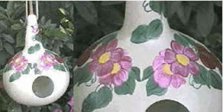 Hand-painted Gourds. Primarily white with pink and purple floral design.